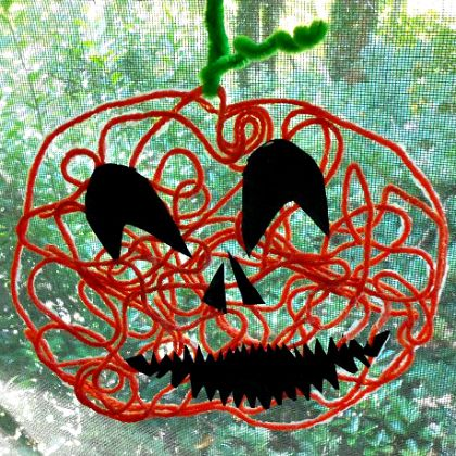 Yarn-Art-Pumpkin-Jack-OLantern-Halloween-Craft-for-Kids-at-Naturally-Educational