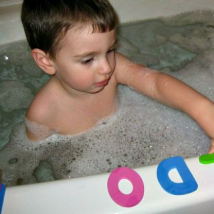 boy-in-bath-with-letters