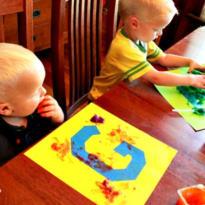 edible finger paint pictured with toddlers