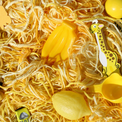 yellow yarn sensory bin