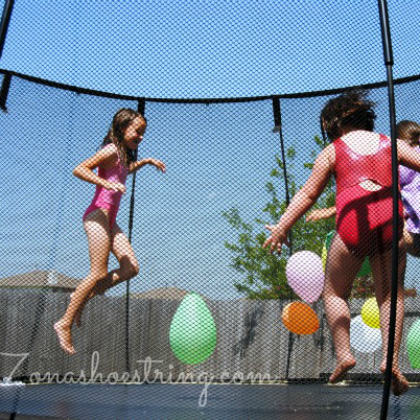 balloon popping on a trampoline