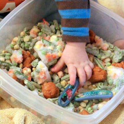 frozen veggie sensory bin