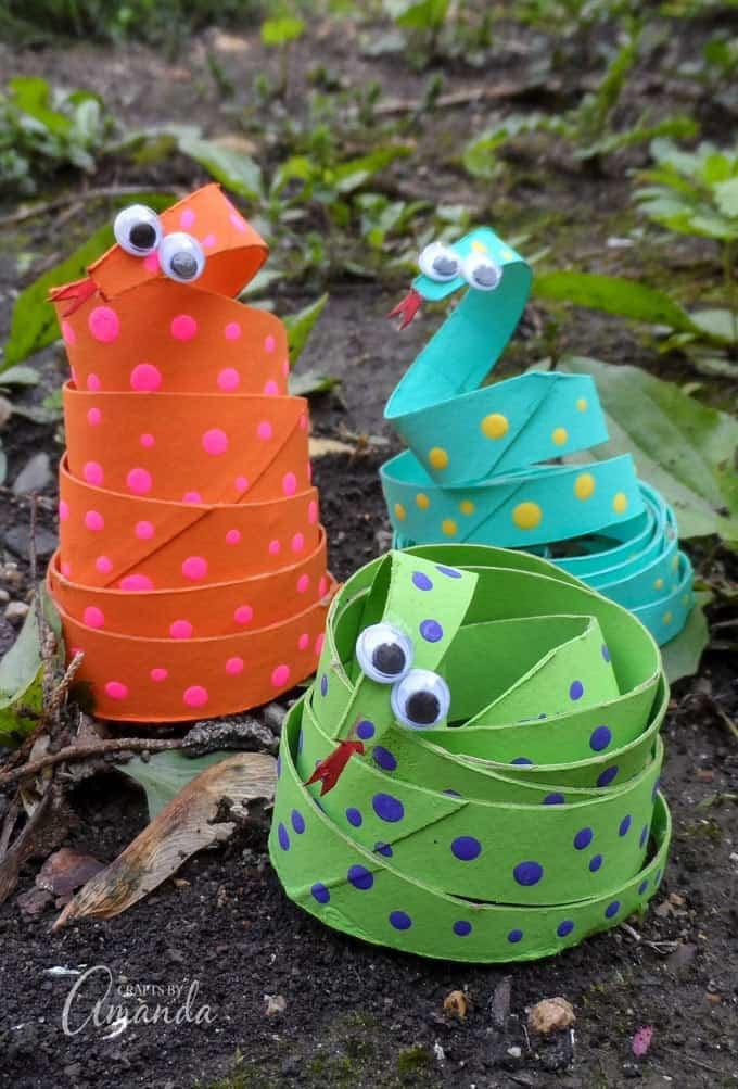 cardboard tube snake craft - 3 finished shown on dirt
