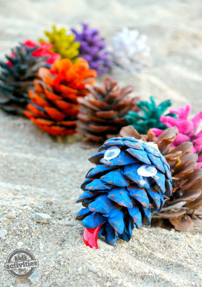 pine cone snake craft (finished) on sand