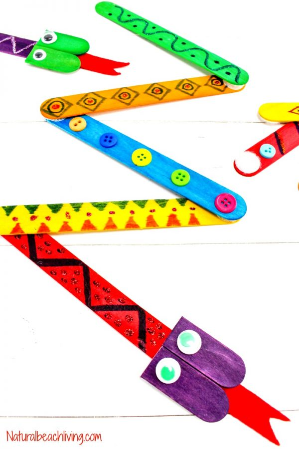 popsicle stick snake craft with different colorful patterns